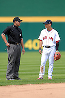 International League Umpire Manny Gonzalez chats with Pawtucket Red Sox' shortstop Jose Iglesias during a game between the Pawtucket Red Sox and Toledo Mud Hens on May 3, 2011 at McCoy Stadium in Pawtucket, Rhode Island. Photo by Ken Babbitt/Four Seam Images.