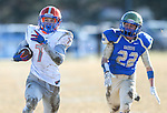 Bishop Gorman's Biaggio Ali Walsh (7) rushes for a touchdown against Reed defender Logan Marcantonio in an NIAA Division I playoff game at Reed High School in Sparks, Nev., on Saturday, Nov. 28, 2015. Bishop Gorman won 41-13. (Cathleen Allison/Las Vegas Review-Journal)