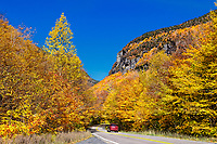 Scenic autumn drive through Smugglers Notch State Park, Vermont, USA.