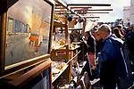 Street market London. Portobello Road.  Saturday traditional antique and brick-a-bat  market stall. 1990s UK 1999