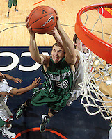 CHARLOTTESVILLE, VA- NOVEMBER 26:  Daniel Turner #22 of the Green Bay Phoenix grabs a rebound during the game on November 26, 2011 at the John Paul Jones Arena in Charlottesville, Virginia. Virginia defeated Green Bay 68-42. (Photo by Andrew Shurtleff/Getty Images) *** Local Caption *** Daniel Turner