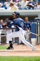 David Gonzalez (18) of the West Michigan Whitecaps follows through on his swing against the Quad Cities River Bandits at Fifth Third Ballpark on May 5, 2013 in Comstock Park, Michigan.  The River Bandits defeated the Whitecaps 5-4.  (Brian Westerholt/Four Seam Images)
