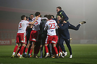 Stevenage players celebrate victory in the penalty shoot-out during Stevenage vs Hull City, Emirates FA Cup Football at the Lamex Stadium on 29th November 2020