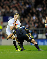 Chris Ashton of England is tackled by Dougie Hall of Scotland during the RBS 6 Nations match between England and Scotland at Twickenham on Saturday 02 February 2013 (Photo by Rob Munro)