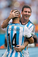 Lionel Messi of Argentina celebrates scoring a goal with Javier Mascherano after making it 2-1