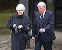 Former Rangers' player and manager John Greig and his wife arrive at Mortonhall Crematorium for the funeral service of Sandy Jardine.