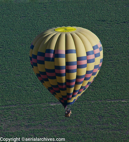 aerial photograph of a hot air balloon flying in the Napa Valley, Napa County, California