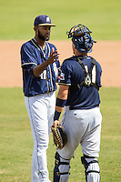 San Antonio Missions pitcher Tayron Guerrero (40) is congratulated by catcher Griff Erickson (11) following the Texas League baseball game against the Midland RockHounds on June 28, 2015 at Nelson Wolff Stadium in San Antonio, Texas. The Missions defeated the RockHounds 7-2. (Andrew Woolley/Four Seam Images)