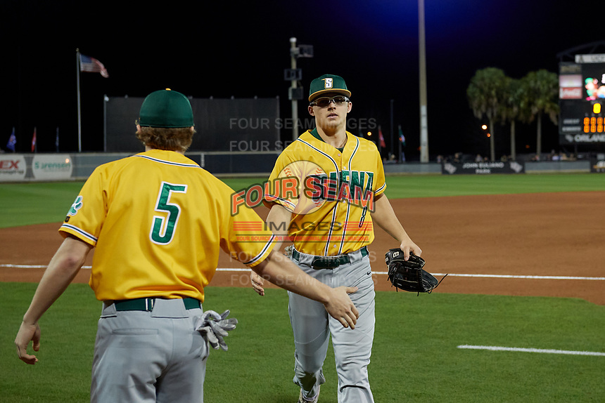 Siena Saints Evan St. Claire (8) high fives Davis Zerr (5) during a game against the UCF Knights on February 14, 2020 at John Euliano Park in Orlando, Florida.  UCF defeated Siena 2-1.  (Mike Janes/Four Seam Images)