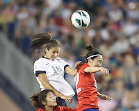 USWNT substitute midfielder Yael Averbuch (16) and Korea Republic substitute midfielder Lee Jungeun (22) battle for head ball. In an international friendly, the U.S. Women's National Team (USWNT) (white/blue) defeated Korea Republic (South Korea) (red/blue), 4-1, at Gillette Stadium on June 15, 2013.