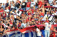 MEDELLÍN -COLOMBIA-28-02-2016. Hinchas de Independiente Medellín animan a su equipo durante el encuentro con Deportivo Cali por la fecha 7 de la Liga Águila I 2016 jugado en el estadio Atanasio Girardot de la ciudad de Medellín./ Fans of Independiente Medellin cheer for their team during a match against Deportivo Cali during the date 7 of Aguila League I 2016 played at Atanasio Girardot stadium in Medellin city. Photo: VizzorImage/León Monsalve/Str