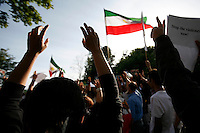 Protesters hold their hands in the air and observe a minute of silence in memory of Iranians killed during the recent unrest. Demonstration in Oslo, Norway, following the election in Iran. A protest arranged by Amnesty International Norway was held in front of the Norwegian Parliament, before Iranian diaspora and others marched to the Iranian embassy to continue their protest. .©Fredrik Naumann/Felix Features.