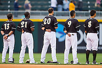(L-R) Carlos Sanchez (13), Jared Mitchell (21), Jordan Danks (20), Gorkys Hernandez (9) and Tyler Saladino (8) line up for the National Anthem prior to the game against the Buffalo Bisons at BB&T Ballpark on May 9, 2014 in Charlotte, North Carolina.  The Knights defeated the Bisons 5-3.  (Brian Westerholt/Four Seam Images)