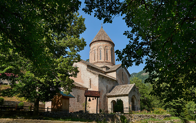 """Pictures & imagse of Timotesubani medieval Orthodox monastery Church of the Holy Dormition (Assumption), dedcated to the Virgin Mary, 1184-1213, Samtskhe-Javakheti region, Georgia (country).<br /> <br /> Built during the reigh of Queen Tamar during the """"Golden Age of Georgia"""", Timotesubani Church of the Holy Dormition is one of the most important examples of medieval Georgian architecture and art. <br /> <br /> Built of pinkish Georgian brick to a cruciform floor plan. The eastern end of the church has 3 apses. Above the centre of the church is a high Georgian style cupola supported on 2 columns."""
