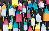 Bar Harbor Maine colorful buoys on wall for sale and state specialty souvenirs for lobster traps catching fishing