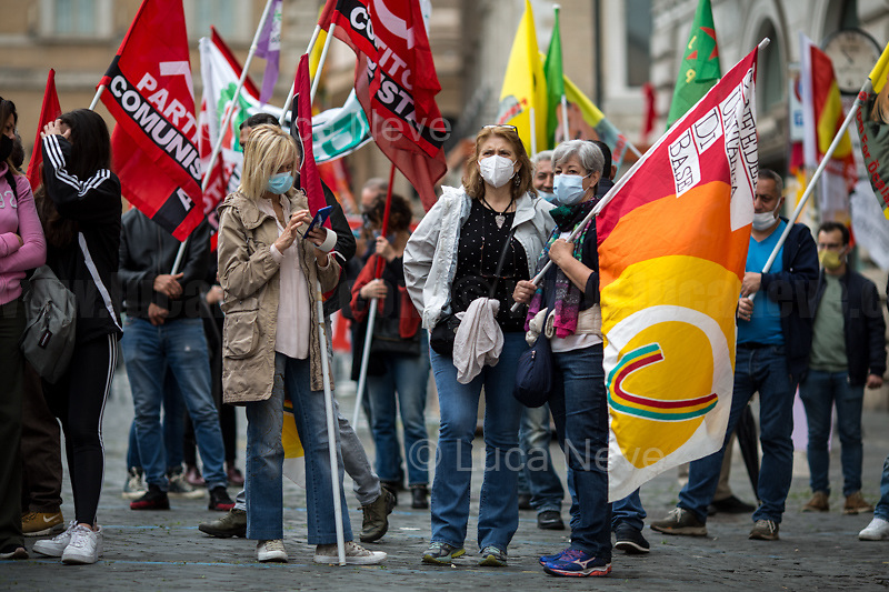 Rome, Italy. 01st May, 2021. Today, hundreds of people, led by CUB Trasporti and USB Trade Unions and extra-parliamentary lefty Parties, gathered in Piazza Santi Apostoli to celebrate the MayDay, International Workers' Day 2021. The topics discussed at the rally, held under pandemic Coronavirus / Covid-19 demonstration restrictions, were various including: the Alitalia crisis, the flag carrier of Italy at risk to be dismantled (1.); Public School, Healthcare and Public Administration/Sector situations; the Italian economic and government situation during the ongoing pandemic Coronavirus / Covid-19; Internationalism, workers' rights and struggles in the world. Finally the rally was organised in support and solidarity with the other demonstrations across the globe.<br /> <br /> Footnotes & Links:<br /> 1. 16.04.2021 - Alitalia Workers Protest At Fori Imperiali and Campidoglio https://lucaneve.photoshelter.com/gallery/16-04-2021-Alitalia-Workers-Protest-At-Fori-Imperiali-and-Campidoglio/G0000unf5F2yc0Ts/C0000GPpTqAGd2Gg<br /> 03.03.2021 - Alitalia Workers Protest Outside Italian Ministry Of Transport https://lucaneve.photoshelter.com/gallery/03-03-2021-Alitalia-Workers-Protest-Outside-Italian-Ministry-Of-Transport/G0000JI_TNBKDjz8/C0000GPpTqAGd2Gg<br /> 23.04.2021 - Alitalia Workers Protest At Rome's Fiumicino Airport https://lucaneve.photoshelter.com/gallery/23-04-2021-Alitalia-Workers-Protest-At-Romes-Fiumicino-Airport/G0000I0vNSqRTV.Q/C0000GPpTqAGd2Gg