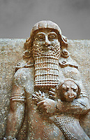 Stone statue of a Hero holding a lion. From facade M of the palace courtyard ,  Inv AO 19861 from Dur Sharrukin the palace of Assyrian king Sargon II at Khorsabad, 713-706 BC.  Louvre Museum Room 4 , Paris