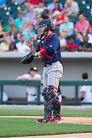 Lehigh Valley IronPigs catcher Koyie Hill (23) goes through defensive signs during the game against the Charlotte Knights at BB&T Ballpark on May 8, 2014 in Charlotte, North Carolina.  The IronPigs defeated the Knights 8-6.  (Brian Westerholt/Four Seam Images)