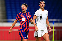 SAITAMA, JAPAN - JULY 24: Carli Lloyd #10 of United States with Abby Erceg #8 of New Zealand during a game between New Zealand and USWNT at Saitama Stadium on July 24, 2021 in Saitama, Japan.