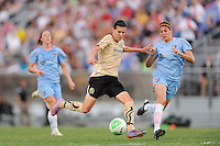 Christine Sinclair (12) of FC Gold Pride takes a shot as Brittany Taylor (14) of Sky Blue FC defends. FC Gold Pride defeated Sky Blue FC 1-0 during a Women's Professional Soccer (WPS) match at Yurcak Field in Piscataway, NJ, on May 1, 2010.