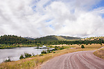 Long and winding courntry road.  Blanchard Lake, within Harpers Lake Fishing Access one mile north of Clearwater Junction on Montana Highway 83.  Fishing is available on two lakes and the Clearwater River.  Campsites, toilets, and ADA access, not to mention terrific Big Sky scenery.