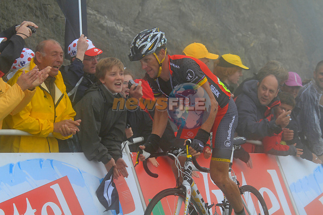 Lance Armstrong (USA) Team Radioshack approaches the summit finish of the Col du Tourmalet during a wet foggy Stage 17 of the 2010 Tour de France running 174km from Pau to Col du Tourmalet, France. 22nd July 2010.<br /> (Photo by Eoin Clarke/NEWSFILE).<br /> All photos usage must carry mandatory copyright credit (© NEWSFILE   Eoin Clarke)