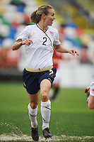 US defender Heather Mitts splashes trough a puddle in a game vs Norway in Olhao, Portugal during the 2010 Algarve Cup.