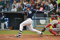 Asheville Tourists catcher Jose Briceno #4 swings at a pitch during a game against the  Greenville Drive at McCormick Field on May 17, 2014 in Asheville, North Carolina. The Tourists defeated the Drive 14-6. (Tony Farlow/Four Seam Images)