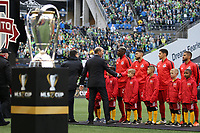 SEATTLE, WA - NOVEMBER 10: MLS Commissioner Don Garber shakes hands with Jonathan Osorio #21 of Toronto FC during a game between Toronto FC and Seattle Sounders FC at CenturyLink Field on November 10, 2019 in Seattle, Washington.