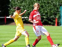 Supercup seizoen 2011 - 2012 ; Kampioen Standard Femina tegen Bekerwinnaar Waasland Beveren Sinaai Girls : Julie Biesmans aan de bal voor Lies Van Hamme.foto DAVID CATRY / Vrouwenteam.be