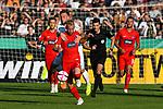 10.08.2019, Donaustadion, Ulm, GER, DFB Pokal, SSV Ulm 1846 Fussball vs 1. FC Heidenheim, <br /> DFL REGULATIONS PROHIBIT ANY USE OF PHOTOGRAPHS AS IMAGE SEQUENCES AND/OR QUASI-VIDEO, <br /> im Bild Marc Schnatterer (Heidenheim, #7) wird von Albano Gashi (Ulm, #7) festgehalten, im Hintergrund Schiedsrichter Florian Badstübner / Badstuebner<br /> <br /> Foto © nordphoto / Hafner