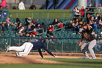 Ashley Graeter (6) of the Modesto Nuts waits for the throw to first base as Brett Phillips (6) of the Lancaster JetHawks dives back to the bag during a game at The Hanger on April 25, 2015 in Lancaster, California. Lancaster defeated Modesto, 5-4. (Larry Goren/Four Seam Images)
