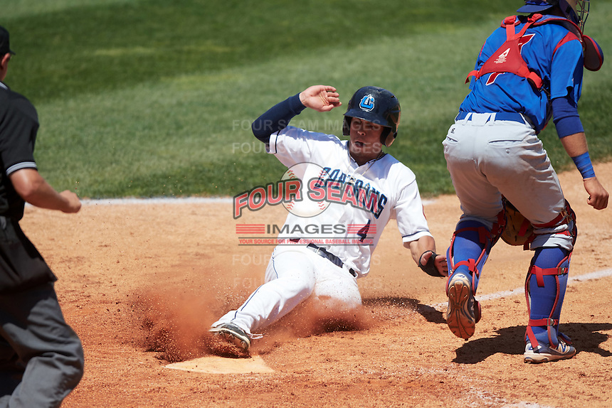 Lake County Captains left fielder Sam Haggerty (4) slides home safely behind catcher P.J. Higgins (7) during a game against the South Bend Cubs on July 27, 2016 at Classic Park in Eastlake, Ohio.  Lake County defeated South Bend 5-4.  (Mike Janes/Four Seam Images)