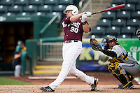 Luke Voit #30 of the Missouri State Bears follows through his swing after making contact on a pitch during a game against the Wichita State Shockers at Hammons Field on May 5, 2013 in Springfield, Missouri. (David Welker/Four Seam Images)