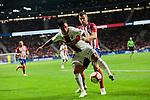 Atletico de Madrid's Lucas Hernandez and SD Huesca's Luis Ezequiel 'Chimy' Avila during La Liga match between Atletico de Madrid and SD Huesca at Wanda Metropolitano Stadium in Madrid, Spain. September 25, 2018. (ALTERPHOTOS/A. Perez Meca)
