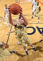 Jan. 22, 2011; Charlottesville, VA, USA; Georgia Tech Yellow Jackets center Daniel Miller (5) grabs a rebound during the game against the Virginia Cavaliers at the John Paul Jones Arena. Virginia won 72-64. Mandatory Credit: Andrew Shurtleff-US PRESSWIRE