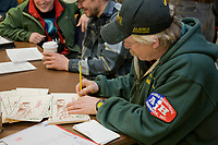 Musher  Jeff King signs mail caches before the start of the All Alaska Sweepstakes dog sled race in Nome, Alaska.