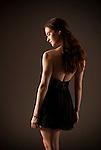 Young woman wearing black dress