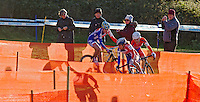 03 NOV 2012 - IPSWICH, GBR - Helen Wyman (GBR) (centre) of Great Britain leads Sanne van Paassen (NED) (right) of the Netherlands and British team mate Nikki Harris (GBR) (left) through a zig-zag section of the course during the elite women's European Cyclo-Cross Championships in Chantry Park, Ipswich, Suffolk, Great Britain. Wyman won the event after a sprint finish with van Paassen in a time of 43 minutes and 52 seconds making her the first Briton to win a senior international cyclo cross championship .(PHOTO (C) 2012 NIGEL FARROW)
