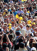 Papa Francesco saluta un bambino al suo arrivo all'udienza generale del mercoledi' in Piazza San Pietro, Citta' del Vaticano, 23 aprile 2014.<br /> Pope Francis greets a child as he arrives to attend his weekly general audience in St. Peter's Square at the Vatican, 23 April 2014.<br /> UPDATE IMAGES PRESS/Isabella Bonotto<br /> <br /> STRICTLY ONLY FOR EDITORIAL USE