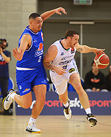 in action during the National Basketball League Final Four semifinal match between Wellington Saints and Auckland Huskies at Te Rauparaha Arena in Porirua, New Zealand on Thursday, 22 July 2021. Photo: Dave Lintott / lintottphoto.co.nz