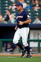 Manager Brian Poldberg (27) of the Northwest Arkansas Naturals walks to the mound during a game against the San Antonio Missions at Arvest Ballpark on June 30, 2011 in Springdale, Arkansas. (David Welker / Four Seam Images)