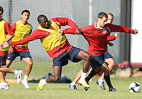 Josmer Altidore (yellow) pulls on Steve Cherundolo during a practice session for the US men's national team at RFK auxiliary field on October 7, 2008 in Washington D.C. prior to the World Cup qualifying match against Cuba.