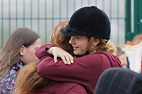 Pictured: Danielle John (R) is embraced by a friend outside St John Lloyd School, in Llanelli, Carmarthenshire, UK. Thursday 12 September 2019<br /> Re: The family of a bullied pupil were joined by friends and held a minute's silence, a year after he hanged himself in school toilets.<br /> His heartbroken father Byron John claims his son Bradley, 14, would still be alive if the school had acted to stop the bullies.<br /> Bradley's 13-year-old sister Danielle found him dead in the toilet block at, an hour after going missing at St John Lloyd Roman Catholic School in Llanelli, South Wales, UK.