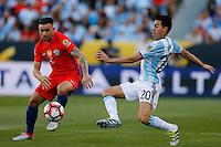 Action photo during the match Argentina vs Chile at Levis Stadium Copa America Centenario 2016. ---Foto  de accion durante el partido Argentina vs Chiler, En el Estadio de la Universidad de Phoenix, Partido Correspondiante al Grupo - D -  de la Copa America Centenario USA 2016, en la foto: (i)-(d) Eugenio Mena, Nicolas Gaitan<br /> <br /> --- 06/06/2016/MEXSPORT/PHOTOSPORT/ Andres Pina