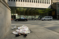 A homeless woman sleeping on the sidewalk facing  the Royal Bank of Canada building on King Street West in downtown Toronto, April 20, 2007.....    photo by Pierre Roussel - Images Distribution