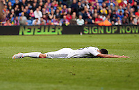 Pictured: Kyle Naughton of Swansea lies on the pitch<br />