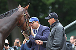 June 5, 2015: Triple Crown hopeful American Pharoah, held by Raul Ramirez (right), gets some affection from his owner, Ahmed Zayat, after his morning gallop at Belmont Park, Elmont, NY. Joan Fairman Kanes/ESW/CSM
