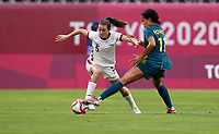 KASHIMA, JAPAN - JULY 27: Kelley O'Hara #5 of the United States dribbles with the ball during a game between Australia and USWNT at Ibaraki Kashima Stadium on July 27, 2021 in Kashima, Japan.