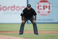 Umpire Drew Maher handles the calls on the bases during the game between the Charleston RiverDogs and the Kannapolis Cannon Ballers at Atrium Health Ballpark on July 1, 2021 in Kannapolis, North Carolina. (Brian Westerholt/Four Seam Images)